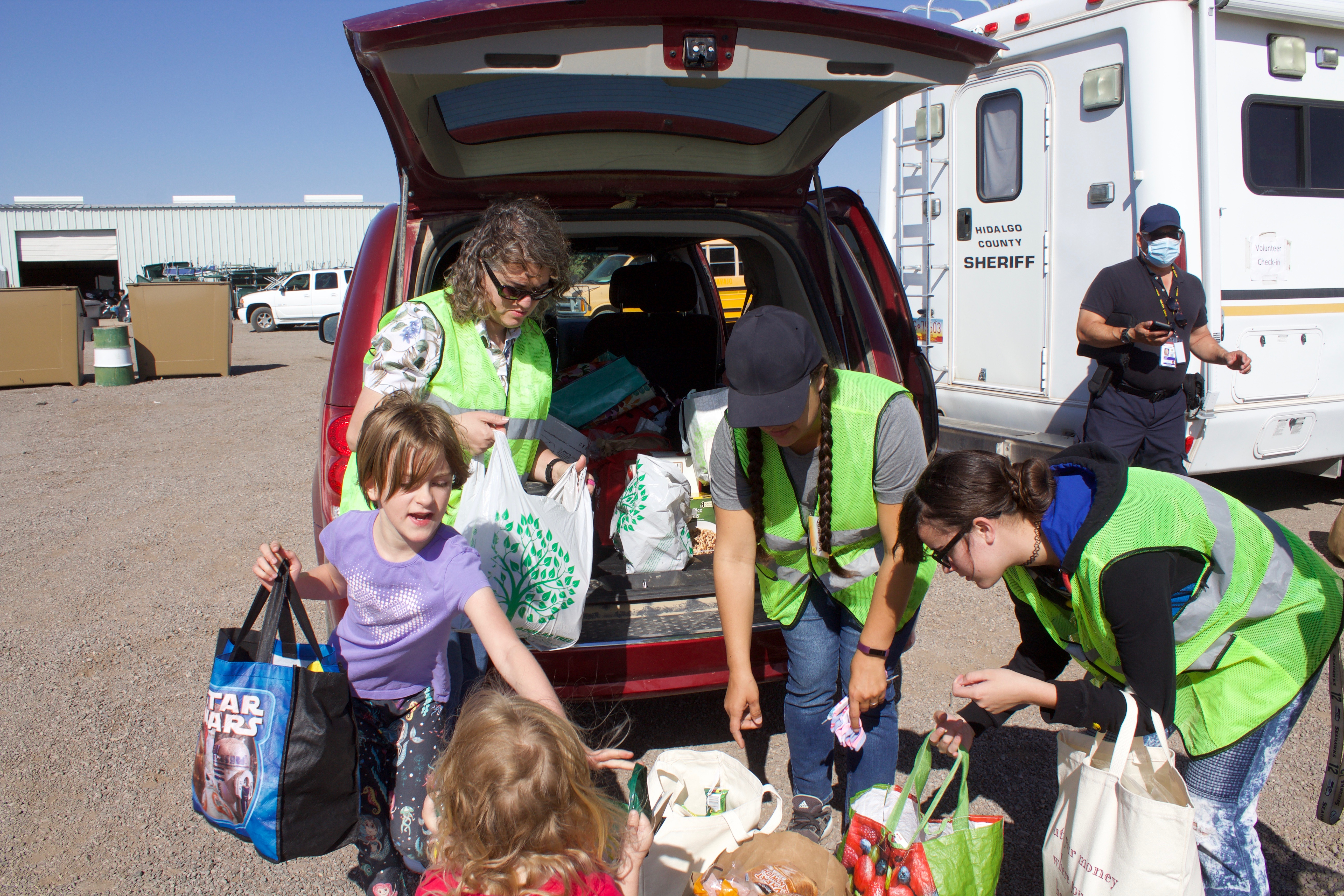 Lillian Connelly, Samantha Armstrong, Juniper Armstrong, Ariana Saludares and another volunteer help with donations at the Southwestern New Mexico State Fairgrounds in Deming on Friday. (Press Staff Photo by  C.P. Thompson)