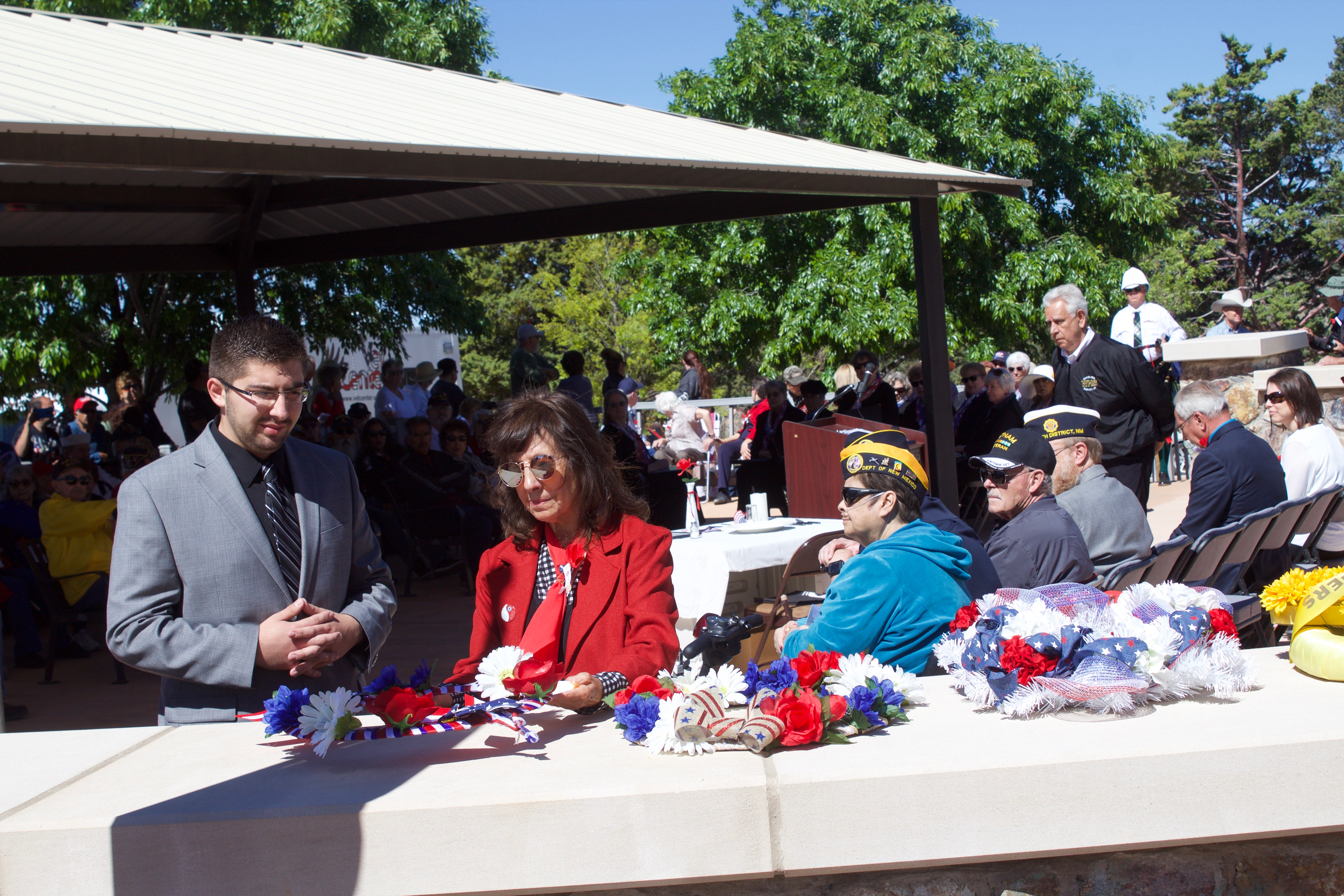 (Press Staff Photo by C.P. Thompson) Lena Holguin puts a wreath down while Luis Terrazas stands next to her during the Memorial Day ceremony at the Fort Bayard National Cemetery on Monday.