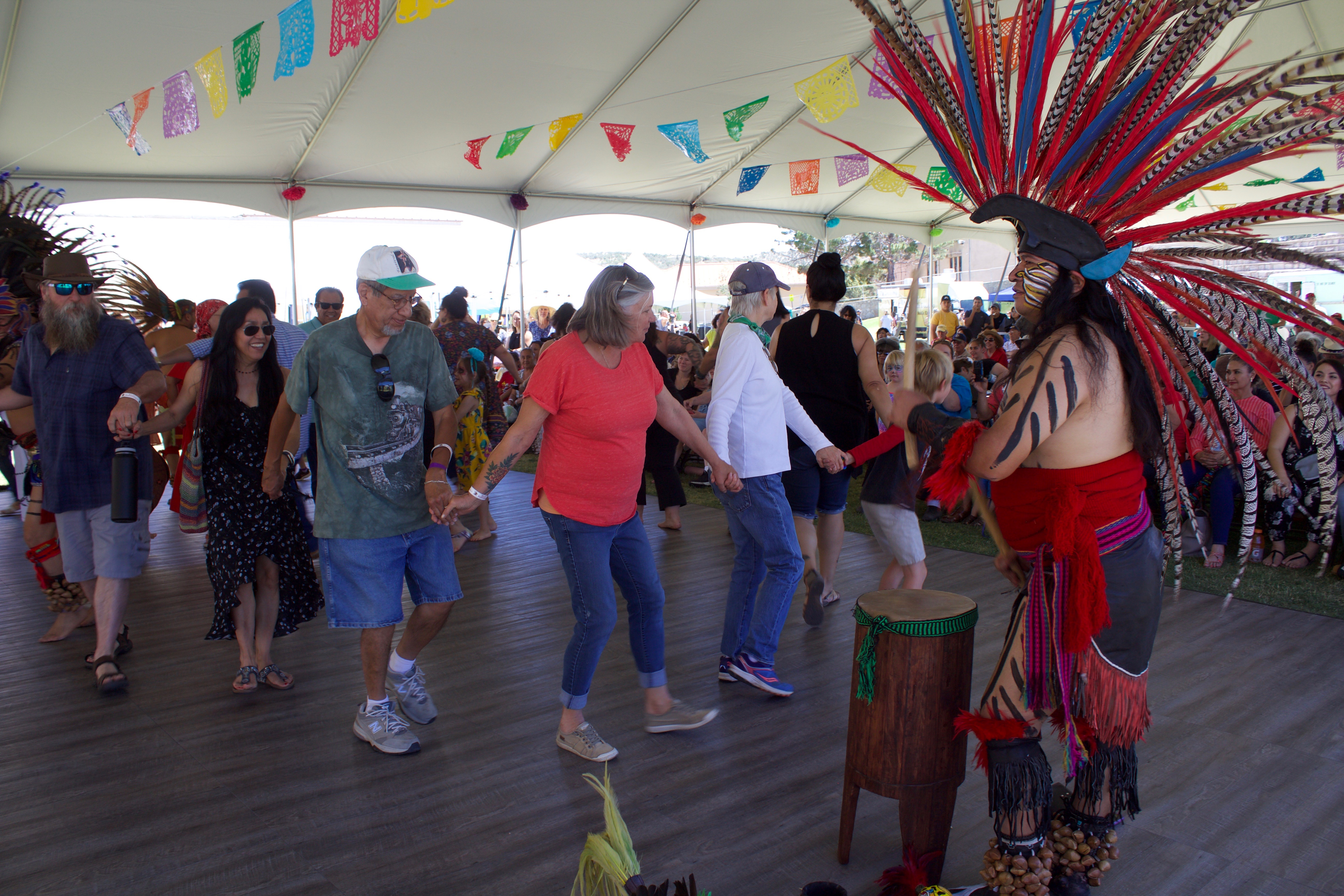 (Press Staff Photo by C.P. Thompson)  A crowd dances with Naucualti Atlachinolli during the third annual ¡Fiesta Latina! at Western New Mexico University on Saturday.