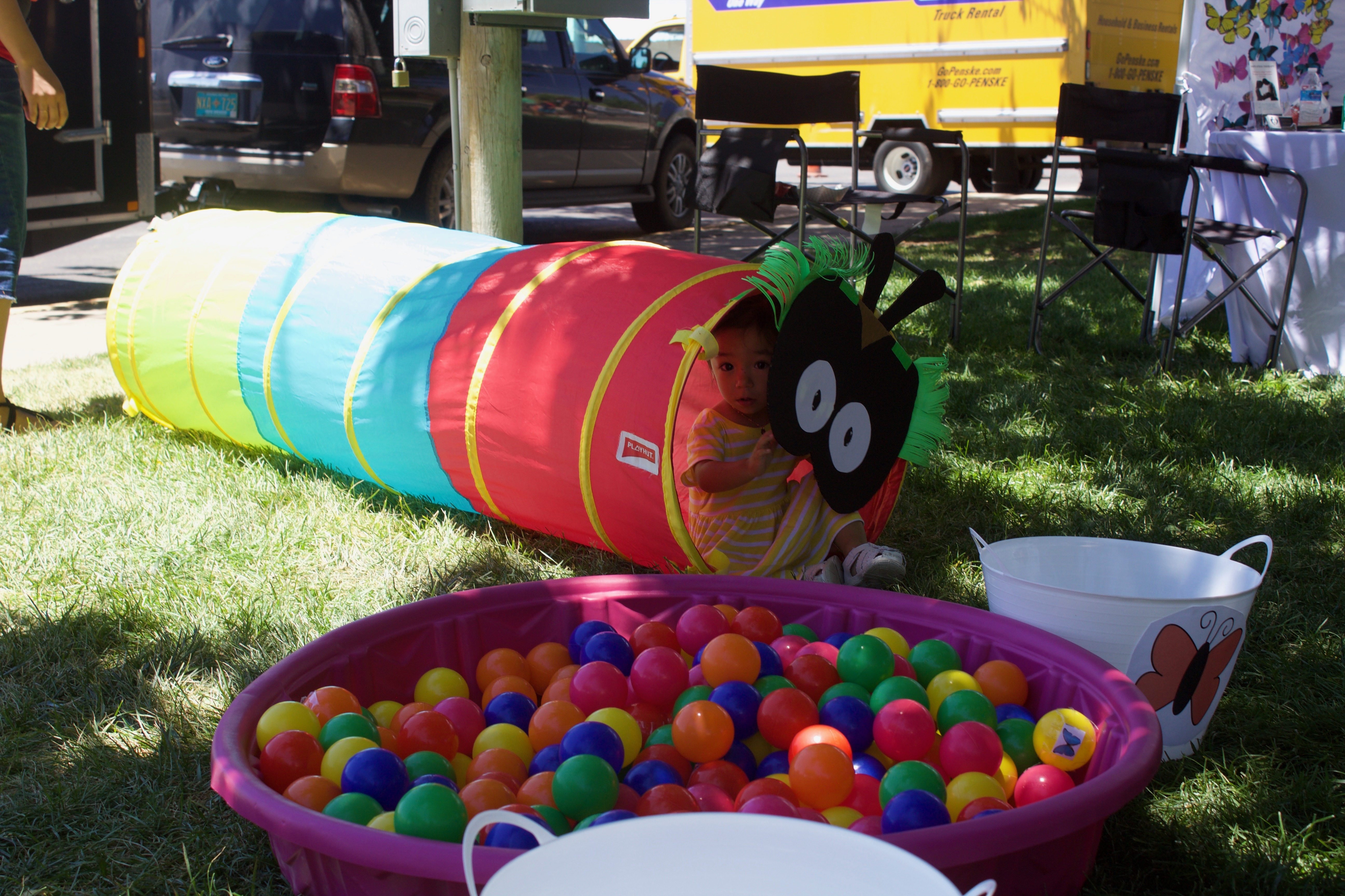 (Press Staff Photo by C.P. Thompson) Selah Marin, 1, hides in a tunnel at the 11th annual Jump into Summer at Gough Park on Saturday. (Press Staff Photo by C.P. Thompson)