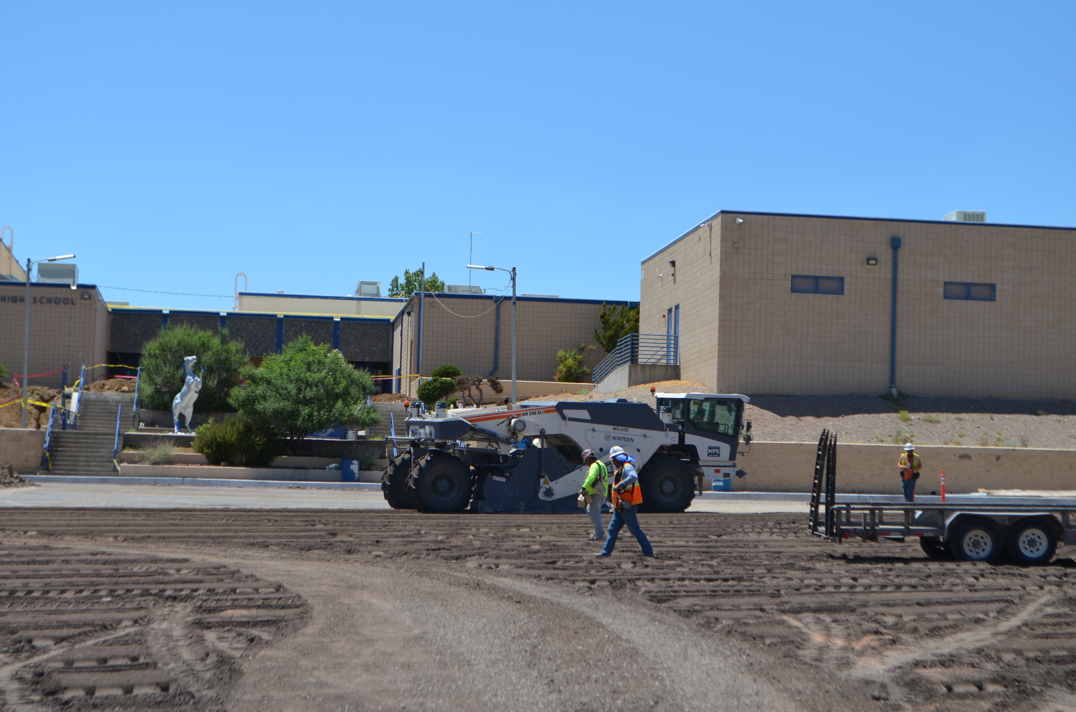 (Press Staff Photo by David Marquez)  HB Construction workers perform maintenance on the student parking lot at Silver High School.