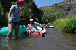 """(Press Staff Photo by David Marquez)  Grecia Nuñez, Angel Peña, and Vynce Bourne embark on a float down the Gila River near the Grapevine Campground as Simon Sotelo and Julie Binko float farther downriver. New Mexico Wild hosted their last local event for Latino Conservation Week, """"The Grapevine and Comida,"""" on Saturday."""