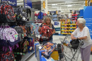 Teresa Moreno and her mother, Betty Moreno, gather supplies for their third family-driven school supply drive that they host in honor of their brother. (Press Staff Photo by David Marquez)