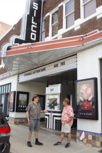 (Press Staff Photo by C.P. Thompson)  Soon-to-be Silco Theatre operators Bob Grunstein and Joe Navan chat outside Monday. They will take over from current operators Chris and Zach Aquino at the end of August.