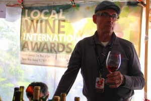 David Arnold (right) and his son, Joshua (left, obscured by wine bottle) work at their booth during the Durango Wine Experience in Colorado on May 5th, 2018. David and His wife, Marcia, will be at the Silver City Wine Festival this weekend, serving and vending various wines from their winery, Wines of the San Juan. (Courtesy Photo)