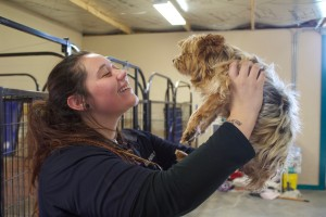 (Press Staff Photo by C.P. Thompson)  Hurley Animal Control Officer Diamond Muller holds up a dog at the animal shelter on Monday. The Hurley Town Council discussed two ordinances on Monday — one on public nuisance and other other on animal control.