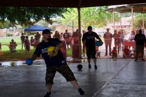 (Press Staff Photo by C.P. Thompson)  Sgt. Tim Tavizon plays dodgeball during National Night Out on Saturday at Gough Park. In the back is Cpl. Daniel Tavizon. The event invited the community to meet members of the Silver City Police Department, Silver City Fire Department and Grant County Regional Dispatch.