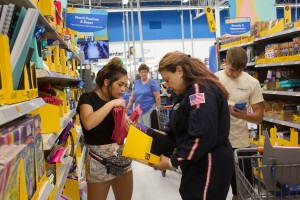 (Press Staff Photo by C.P. Thompson)  Kimberly Barragan and Rashel Barragan shop for school supplies at Walmart on Saturday during the sixth annual Soaring for School Supplies drive. School supplies that were purchased and donated Saturday will go toward several Grant County schools.