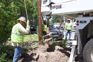 PNM workers Cordell Davis, Jordan Yates and Kevin Rodriguez watch a hole being drilled on Sixth Street on Tuesday. Not pictured is Richard Martinez. The work was for replacing an electric pole.