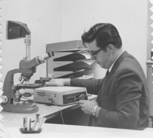 Rex Kilgore, when he was younger, works on a machine. He worked for IBM for 30 years, fixing everything from copiers to typewriters. Rex passed away Aug. 20. (Courtesy Photo)