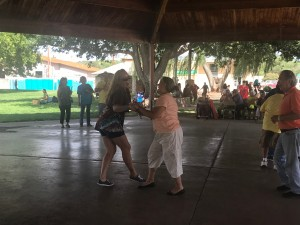 (Press Staff Photo by C.P. Thompson)  Krystal Dupree and Marisol Villasana dance during Carnitas, Musica y Mas at Gough Park on Sunday. The event featured live music from different genres like country and mariachi.