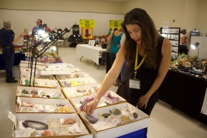 (Press Staff Photo by C.P. Thompson)  Karen Brown looks at minerals during the 36th annual Gem and Mineral Show at the Grant County Veterans Memorial Business and Conference Center on Sunday. The event was hosted by the Grant County Rolling Stones Gem and Mineral Society and featured dozens of vendors.