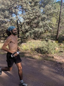 Tony Russ runs to Pine, Ariz., on Friday morning ahead of the Mogollon Monster 100, which begins Sept. 14. He is currently on a 400-mile run, which started in Pinos Altos, and people can pledge a donation during his trip. (Courtesy Photo)