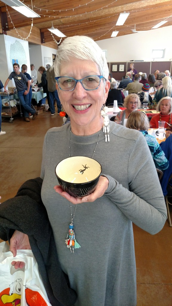 (Photo by Kendra Milligan for the Press)  Colleen Kernahan holds her Empty Bowl, soon to be filled with soup, at this year's Empty Bowls fundraiser, held Saturday at The Commons in Silver City.