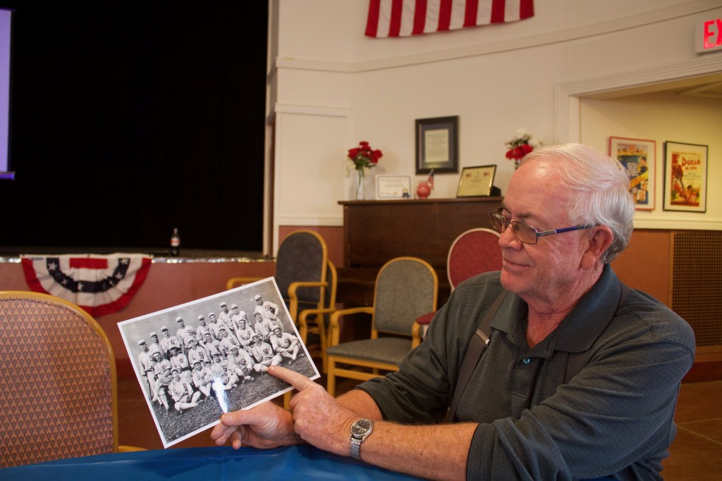 Doug Dinwiddie looks at a photo of the 1919 Chicago White Sox on Friday at the New Deal Theater in Fort Bayard. Two of those players came to Grant County to play in the Copper League.  (Press Staff Photo by C.P. Thompson)
