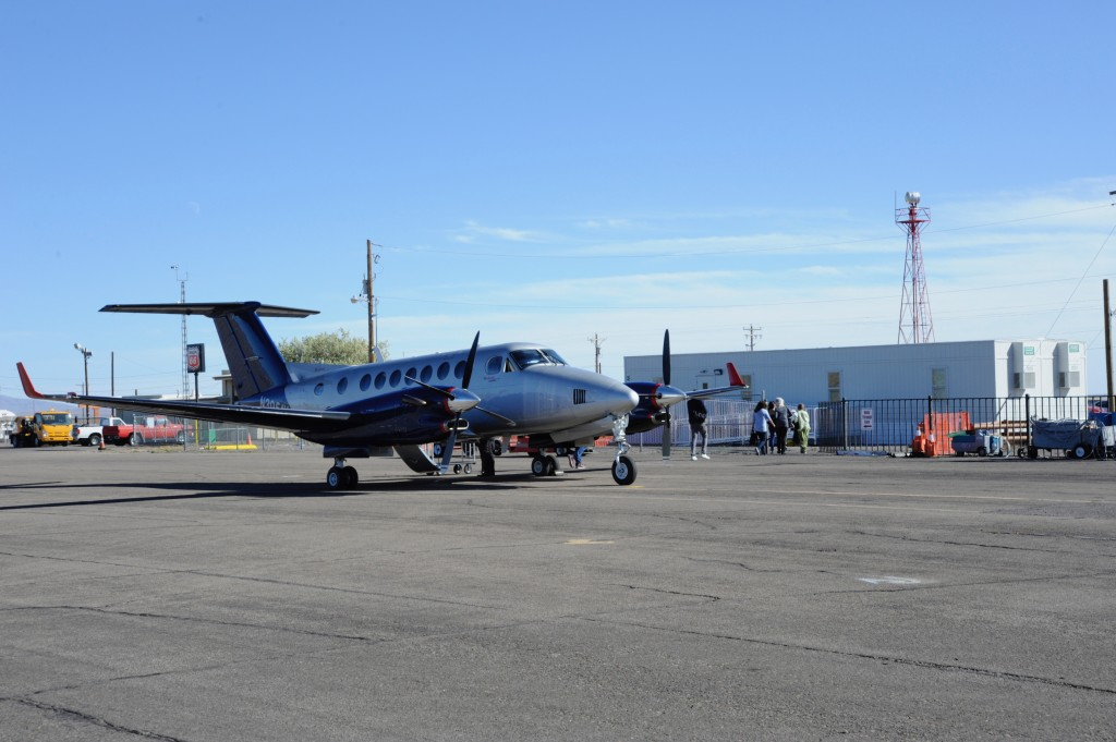 (Press Staff Photo by Geoffrey Plant)  Advanced Air passengers disembark and head to the temporary commercial air terminal at the Grant County Airport. The original, David D. Diaz Terminal, was built in the 1960s and is undergoing extensive renovations that will continue into next spring.