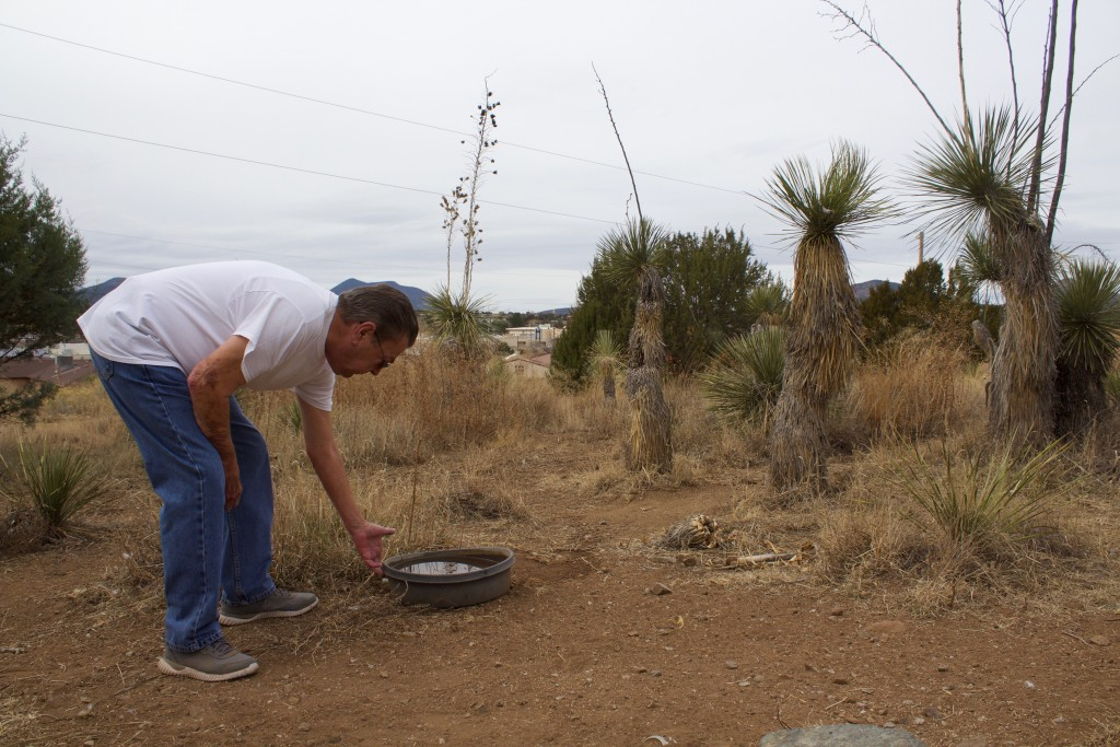 (Press Staff Photo by C.P. Thompson) Steve May stands next to a water bowl that is for deer near his home Tuesday where a new Dollar General may go. The store, which is still being contemplated, would be located at 1330 E. 32nd St. May is against a store being placed there.