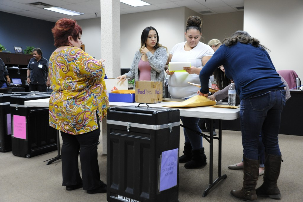 (Press Staff Photo by Geoffrey Plant)  Carmen Castanon brings a ballot box from the Bayard Community Center voter convenience center into the Grant County clerk's office on local election night Tuesday.