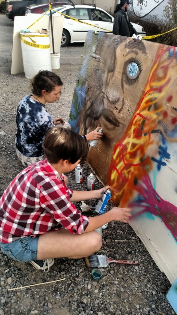 (Press Staff Photo by Kendra Milligan) Aldo Leopold Middle School students Cedar Markham (in foreground) and Lily Myers collaborate on a graffiti panel to raise awareness about environmental issues during Saturday's Graffiti Fest.