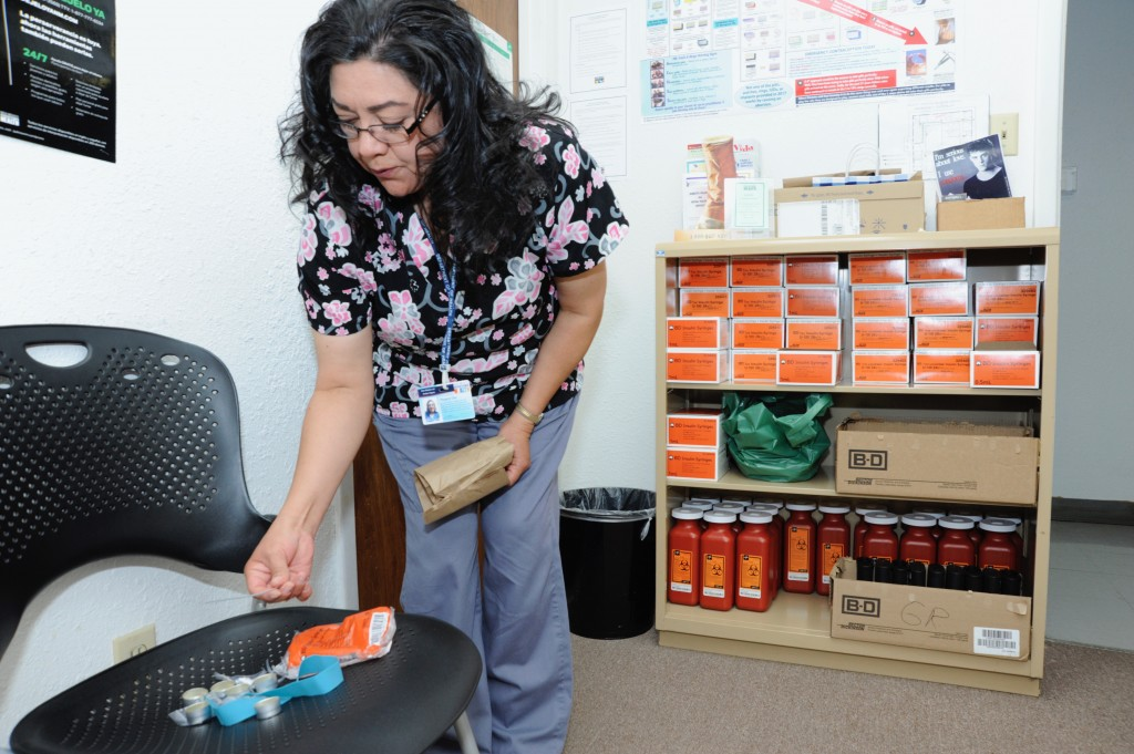 (Press Staff Photo By Geoffrey Plant)  Margaret Diaz, nurse manager for the Grant County Public Health Office, shows what comes in a harm reduction kit for injection drug users who use the needle exchange program across New Mexico. Items include tourniquets, cotton filters, cookers, twist ties to make handles for the cookers, and a bag of 10 .28-gauge, half-inch-length, 100-cc syringes. The exchange also provides hundreds of new syringes at a time if a person asks.