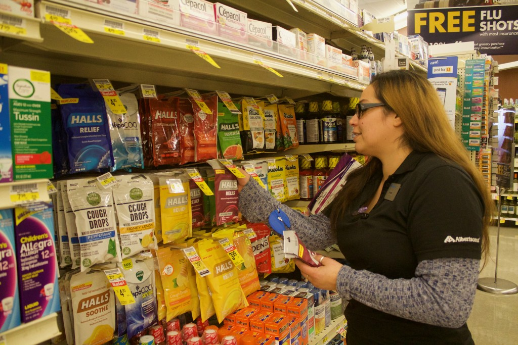 (Press Staff Photo by C.P. Thompson) Dani Ochoa holds cough drops at Albertsons on Friday. New Mexico has already had more than 20 deaths caused by influenza and pneumonia.