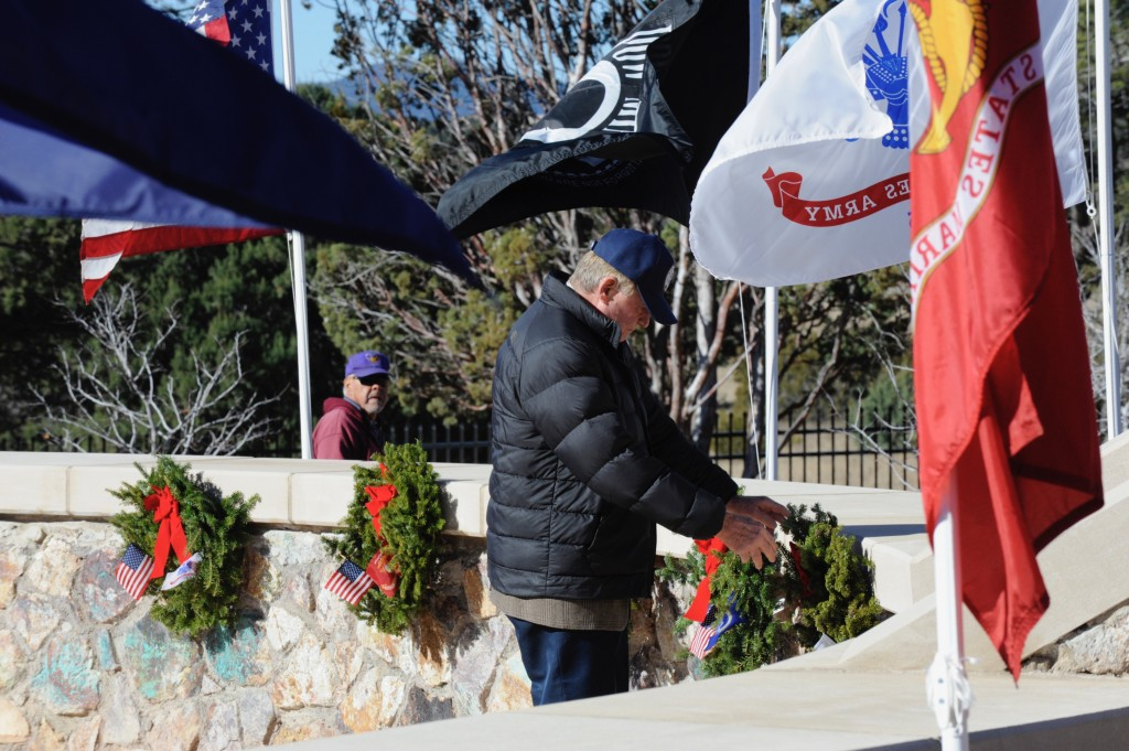 (Press Staff Photo by Geoffrey Plant)  Ken Ladner, mayor of Silver City, places a wreath at the Fort Bayard National Cemetery Veterans Memorial during a ceremony Saturday morning. In addition to Fort Bayard, National Wreaths Across America Day was observed at the Hurley, Santa Clara, and 1,600 other cemeteries across the U.S.