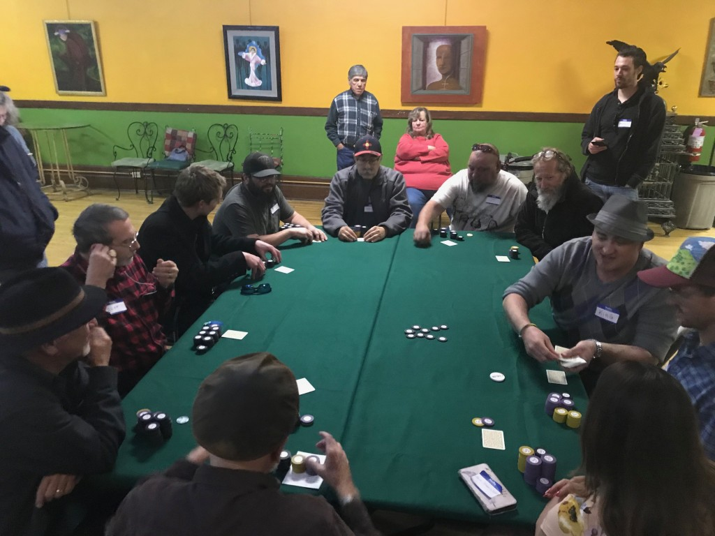 (Press File Photo by C.P. Thompson) King Crowder deals cards to the final 10 players during the CLAY Festival Poker Tournament Fundraiser in the ballroom of the Old Elks Lodge last year. This year's poker tournament begins at 3 p.m. Saturday at the Murray Hotel ballroom.