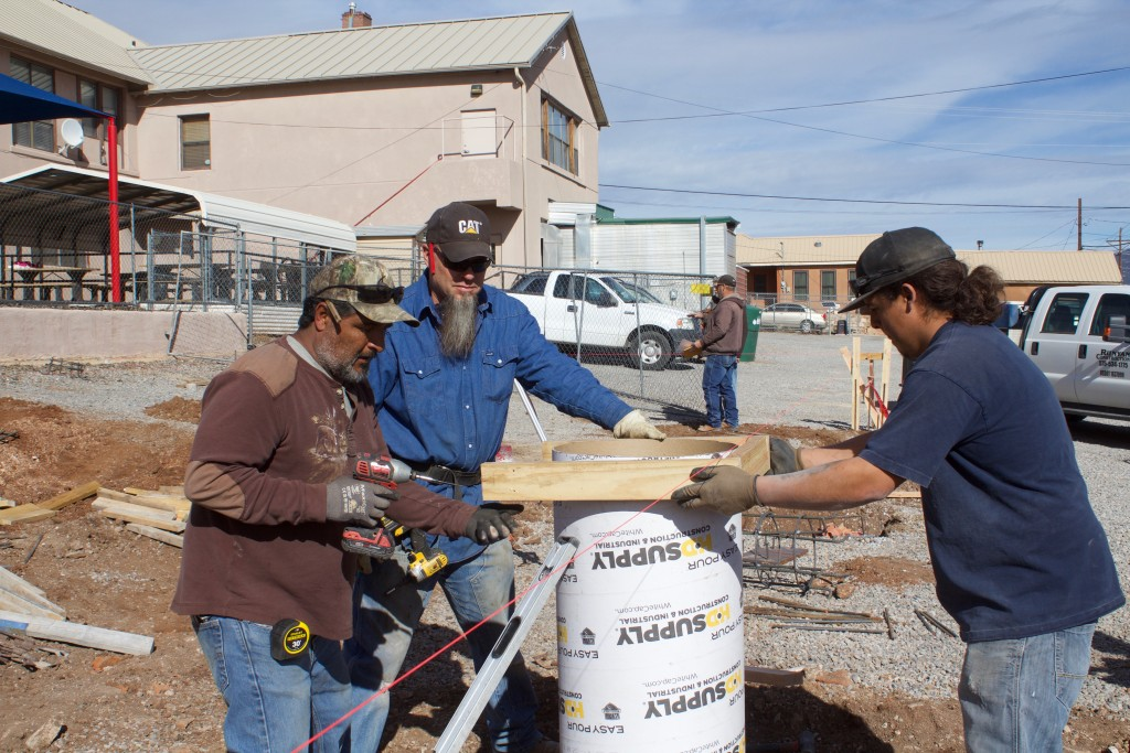 Rosendo Torres Sr., Ralph Peters and Rosendo Torres Jr. get to work at El Grito Head Start on Thursday. Misty Pugmire, executive director of the school, said that Runyan Construction is building a foundation for a portable building, which was given by Silver Consolidated Schools. The school received $50,000 in funds from the state. The portable will have two classrooms, and the plan is to have kids in there by August.