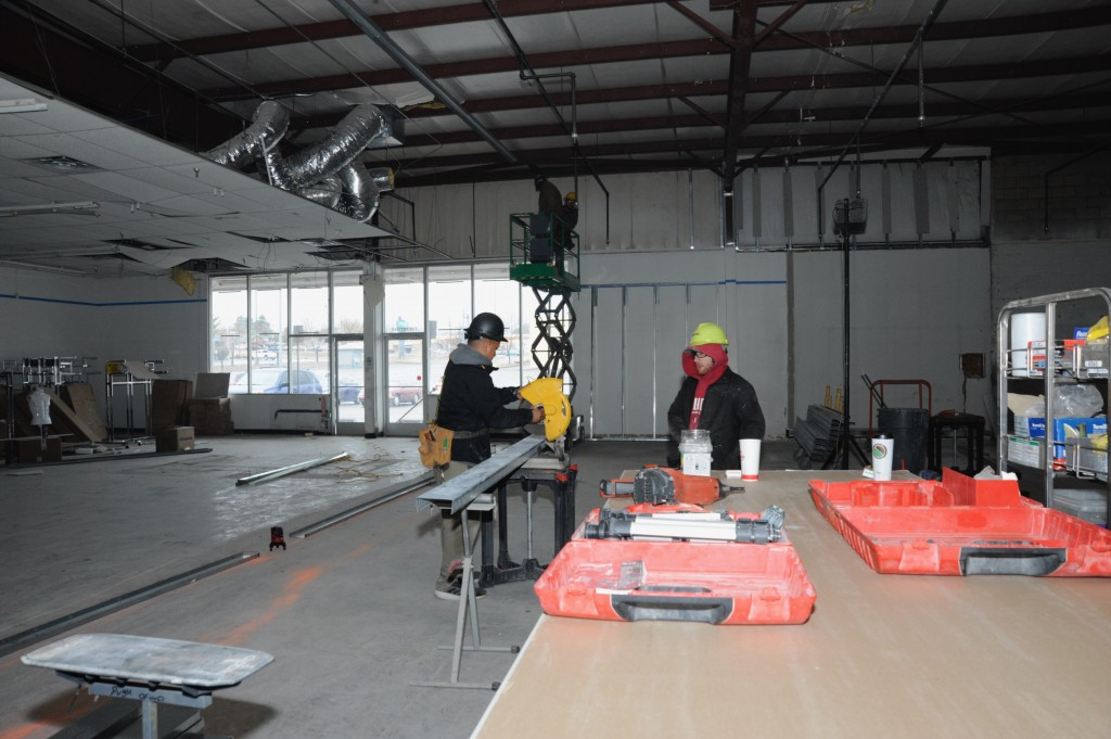 (Press Staff Photo by Geoffrey Plant)  Construction worker John Hundley, left, and foreman Ian Pugh cut materials to frame a wall at the front of the new Harbor Freight Tools location at 2154 Silver Heights Blvd. in Silver City. A grand opening for the store is scheduled for April 11.
