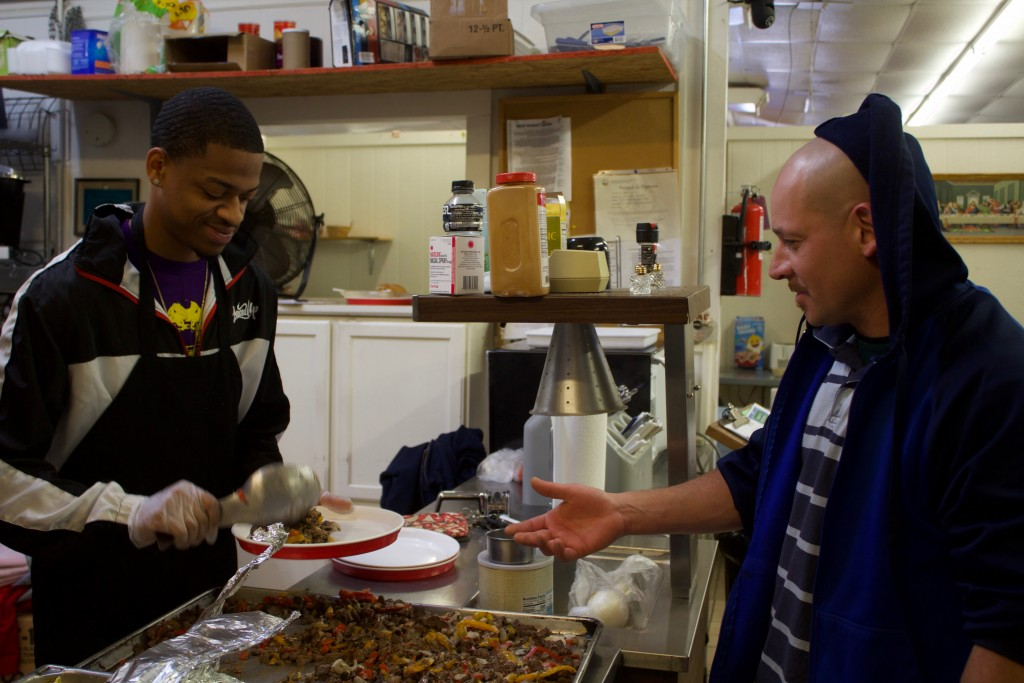 (Press Staff Photo by C.P. Thompson)  LeRon Reed serves Jose Alvarez food at the Silver City Gospel Mission on Saturday. WNMU hosted different events the past few days for Martin Luther King Jr.