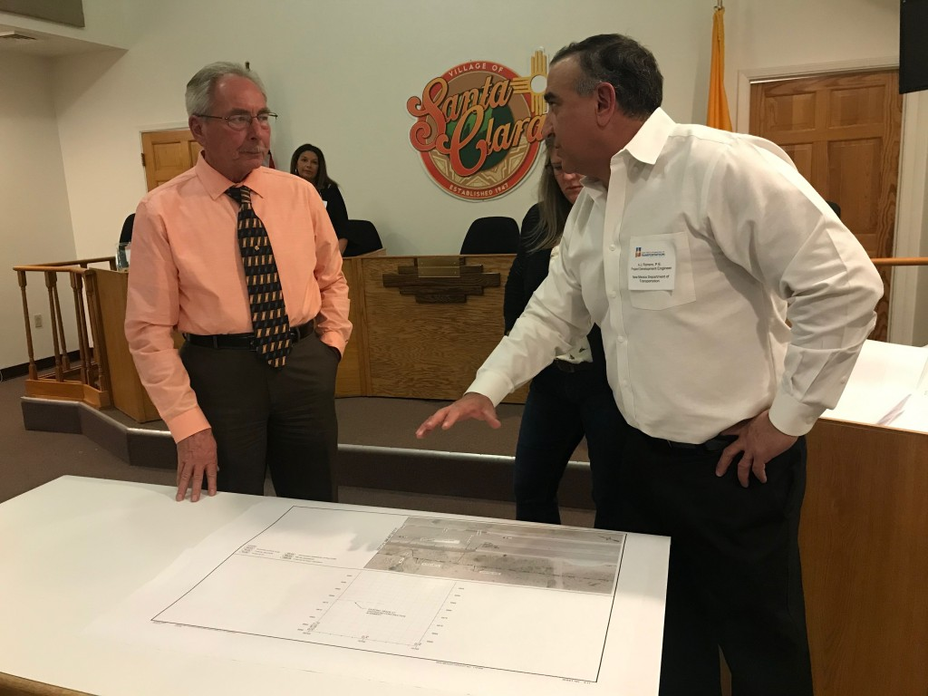 (Press Staff Photo by C.P. Thompson)  A.J. Romero, project development engineer for the NMDOT, and Santa Clara Mayor Richard Bauch talk at the village's City Hall on Thursday. The trail will be from mile markers 120 to 122 on U.S. 180, with construction set in late summer.