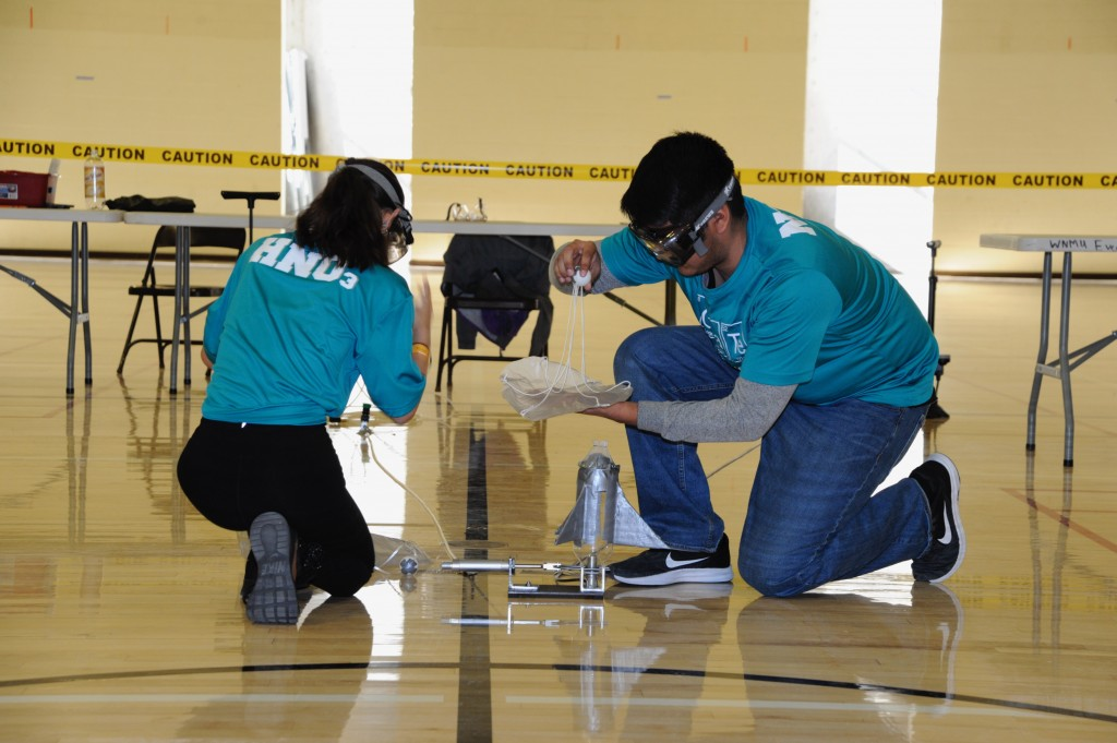 (Press Staff Photo by Geoffrey Plant)  Las Cruces High School seniors Megan Apodaca and Nicholas Tabullo prepare their pingpong parachute rocket at the 2020 Southwest Regional Science Olympiad at Western New Mexico University on Saturday.