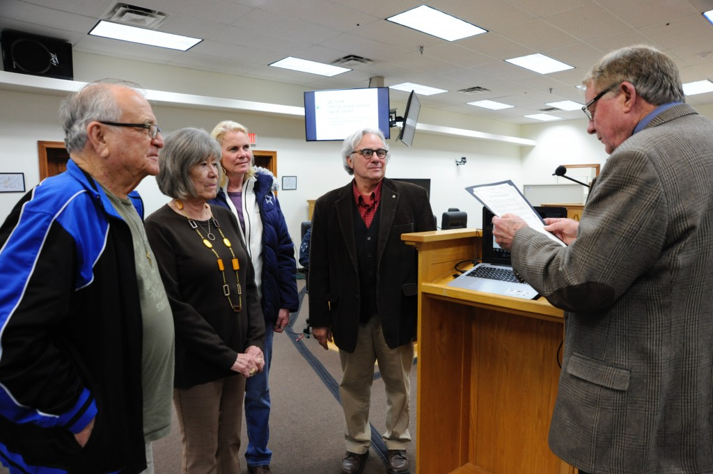 (Press Staff Photo by Geoffrey Plant)  From left: Tommy Ryan, Patsy Madrid, Kim Pearce and Chairman Bart Roselli of the Territorial Charter Day Committee accept a proclamation from Silver City Mayor Ken Ladner officially designating Feb. 15 as Territorial Charter Day. Committee member Al Gamboa is out-of-frame.