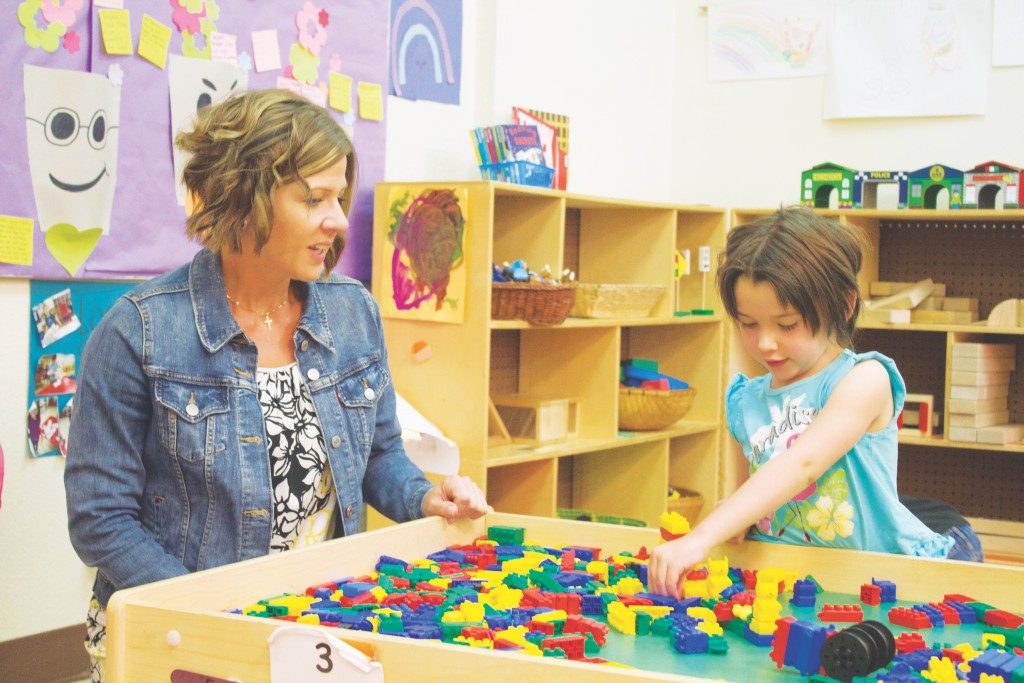 (Press File Photo by C.P. Thompson)  Shannon Rivera watches Azaleigh Emery play with legos at Western New Mexico University's Early Childhood Programs in April. Rivera, former executive director of Early Childhood Programs, left the position in August.