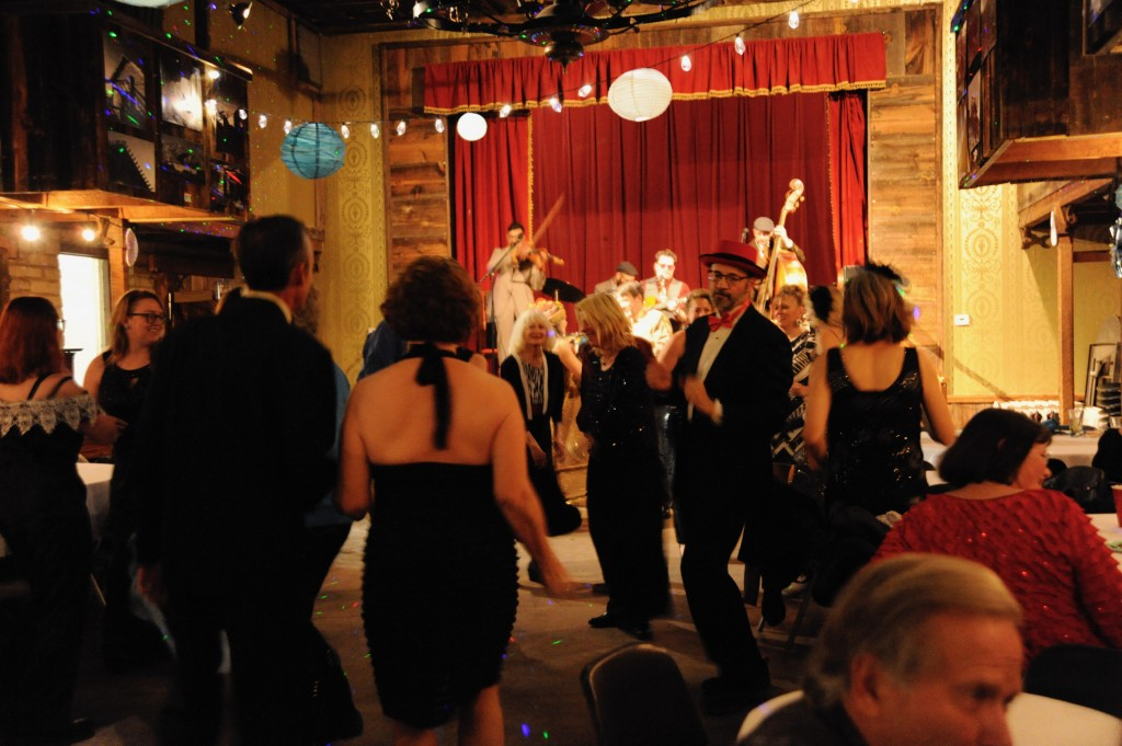 (Press Staff Photo by Geoffrey Plant)  Hundreds of celebrants packed the Buckhorn Opera House for the Virus Theater's annual Winter Ball on Saturday night, including Grant County Commissioner Harry Browne, who came to get down. The band, Le Chat Lunatique, from Albuquerque, came to Pinos Altos to play their Django Reinhardt-         inspired jazz at the event.