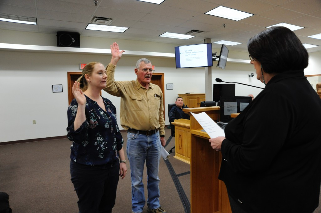(Press Staff Photo by Geoffrey Plant)   Town Clerk Ann Mackie swears in Jaime Embick, community development director for Silver City, and W. Jay Garard during a public hearing at Thursday's Town Council meeting. The town agreed to fix a split zoning issue at Garard's former office on Juniper Street, which was zoned both residential and commercial.