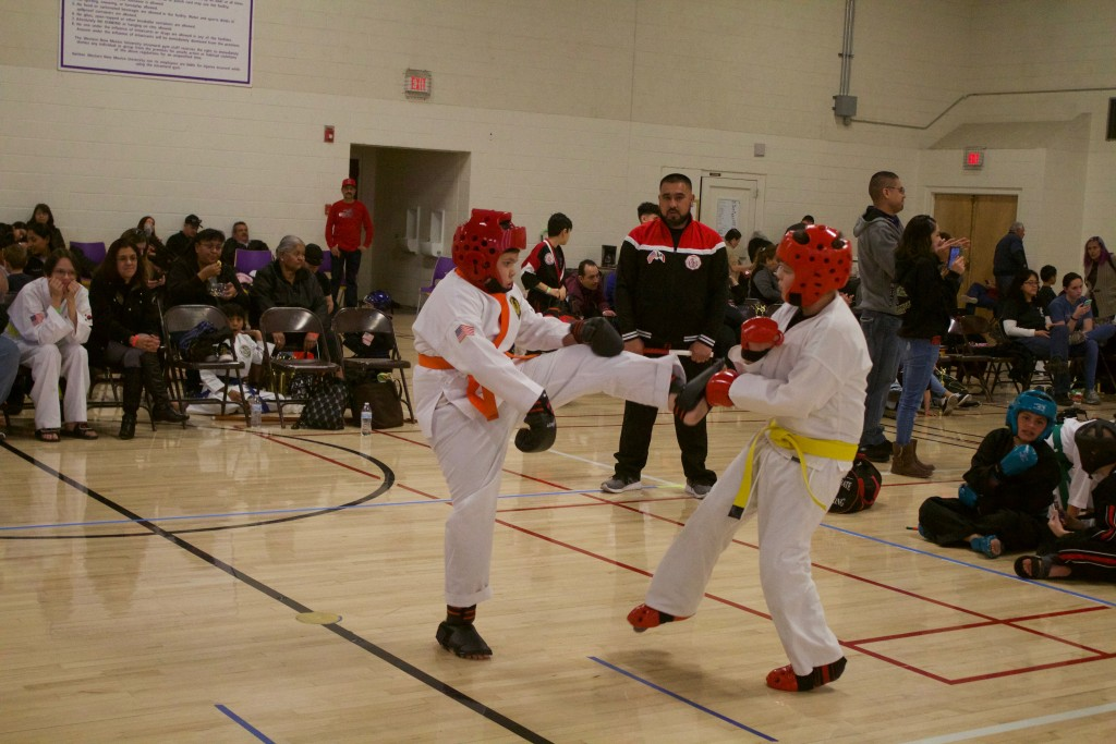 Trenton Palomarez spars with Aron Ibanez during the third annual of Battle of the Gila at the Western New Mexico University's intramural gymnasium Saturday. The event was hosted by Oni Ken Karate.