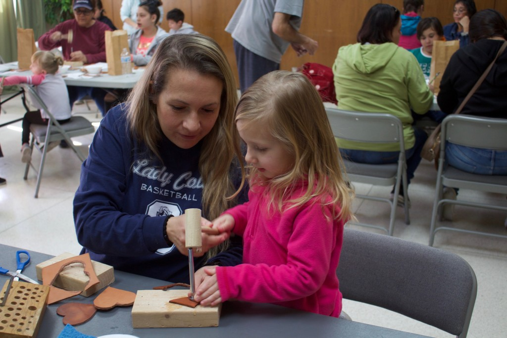 Talmai and Braylyn Nickerson, 3, work on a valentine at the Silver City Museum Annex on Saturday. Erin Griffith, interim educator for the museum, said folks had the chance to use leather tooling to make a personal valentine.