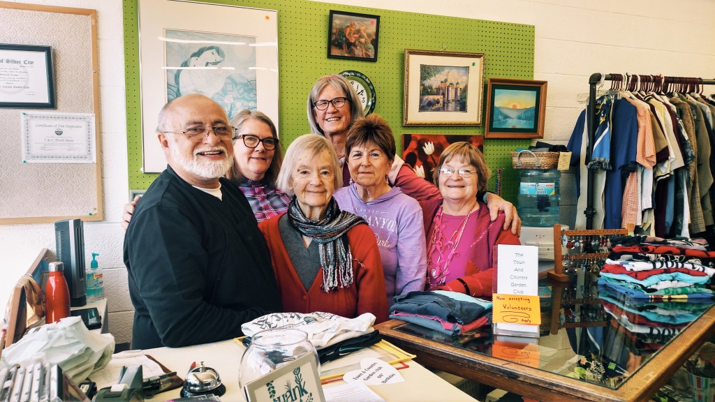The Town and Country Garden Club benefits the community through their thrift store. They paused for a moment to celebrate their 60 years of success. Pictured from left are store manager Henry Escamilla, club President Maggie Jensen, volunteer Harriet Rogers, Vice President Susan Golightly, Treasurer Joella McNally and Secretary Luanne Brooten. (Press Staff Photo by  Kendra Milligan)