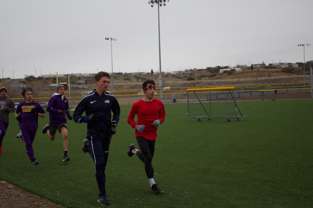 Daniel Beam, decked out in USA gear, runs with his teammates at Scott Park on Friday. Running with him are Roberto Cota, Sebastian Mendoza, Erick Arambula and Michael Anzures. Beam will be representing the USA team Saturday, Feb. 29, during the 2020 Pan Am Cross Country Championships. (Press Staff Photo by C.P. Thompson)