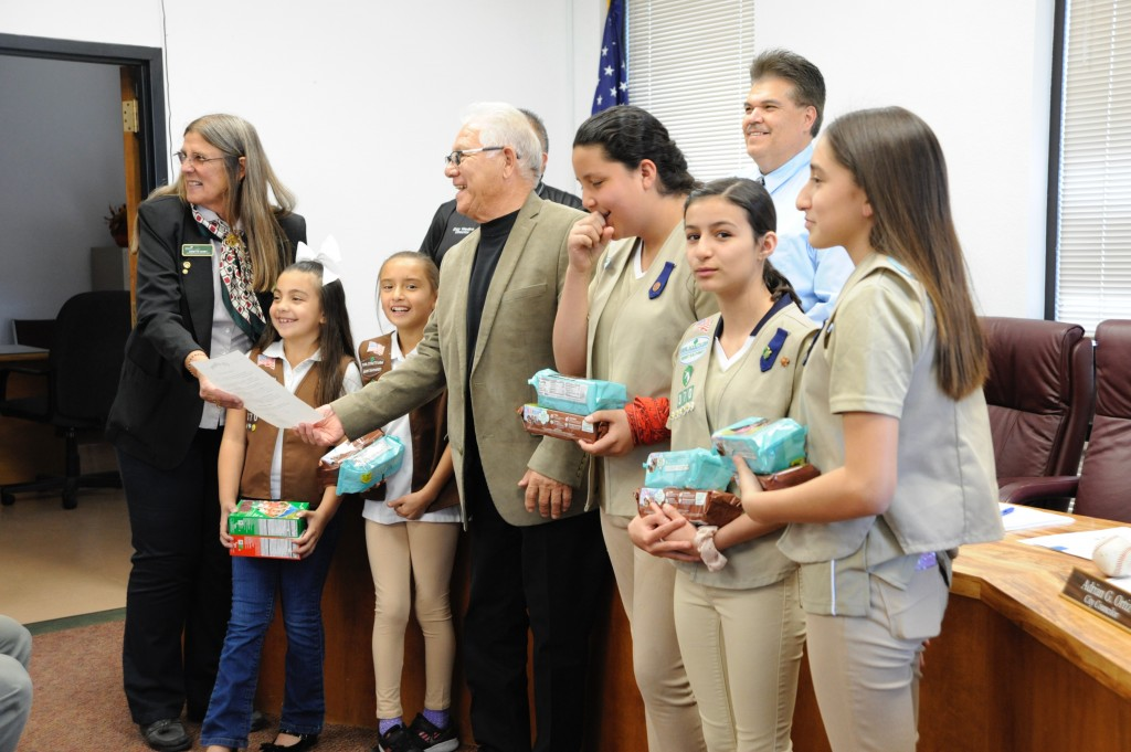 """(Press Staff Photo by Geoffrey Plant) Girl Scouts Membership Manager Annette Toney and members of Troop 54370 from Bayard and Hurley accept a proclamation from Bayard Mayor Chon Fierro and councilors, declaring the week of March 9 as Girl Scout Week. """"March 12 marks the 108th anniversary of the Girl Scouts of the United States of America,"""" Fierro read from the proclamation."""