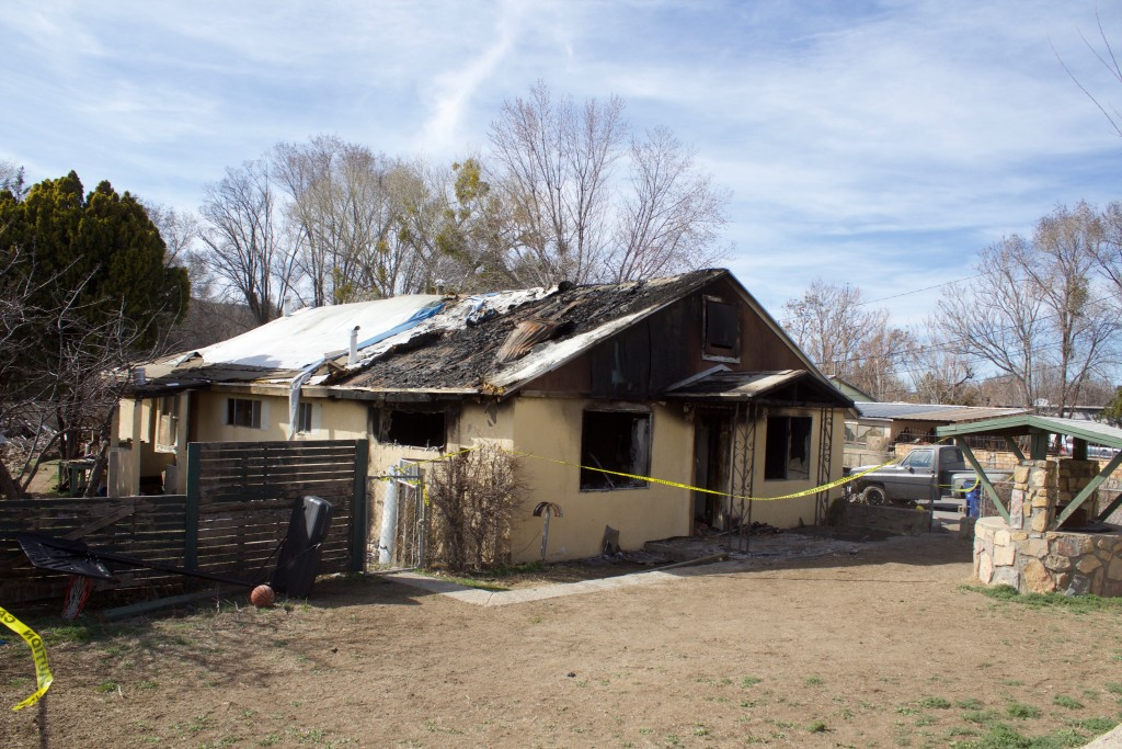 (Press Staff Photo by C.P. Thompson)  The remains of a home Thursday that was allegedly set on fire Tuesday morning. A man, who is charged with arson, is alleged to have set a couch on fire.