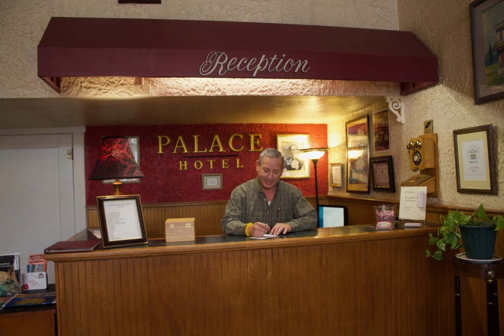 (Press Staff Photo by C.P. Thompson) Steve Aragon works at the Palace Hotel on Tuesday. Paul Aragon, Steve's brother, is the new owner of the hotel, formerly owned by Nancy Johnson for 30 years.