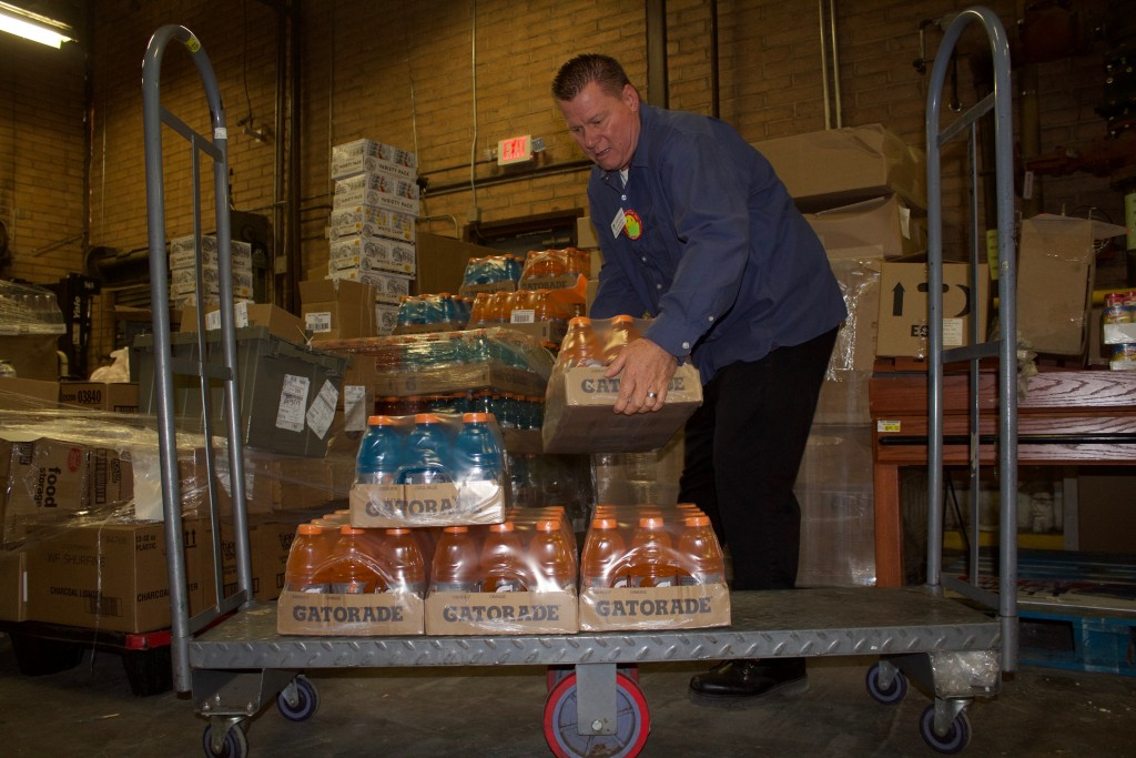 (Press Staff Photo by C.P. Thompson)  Alan Walsmith stacks Gatorade onto a cart at Silver City's Food Basket on Tuesday. Grant County stores are adjusting to product shortages because of the coronavirus pandemic.