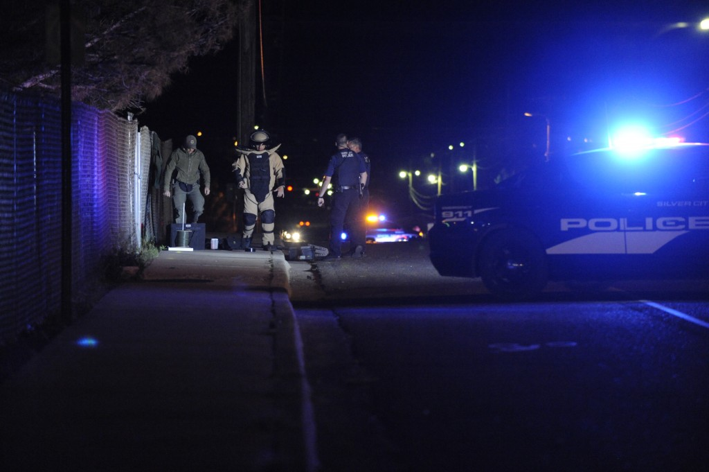 (Press Staff Photo by Geoffrey Plant)  Silver City police officers assist members of the New Mexico State Police bomb squad during a suspicious package investigation on Swan Street above Fox Field around 11 p.m. Tuesday.