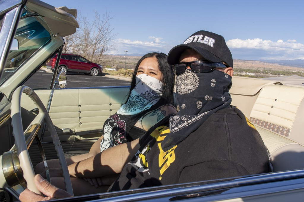 (Searchlight New Mexico Photo by Don J. Usner) Donna Padilla and Fred Rael sit in Rael's lowrider in Española.