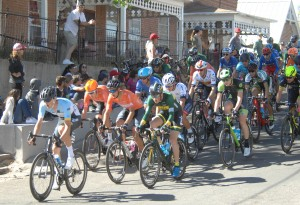 (Daily Press Staff File Photos) Downtown Silver City was full of bike racers as the Tour of the Gila held its Saturday criterium stage during the 2018 race. Above, Men's UCI racers top the hill on Cooper Street in front of race fans.