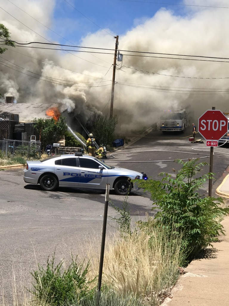 (Photo Courtesy of Jay Ortiz) A fire destroyed this home on Kentucky Street on Sunday afternoon. Above, firefighters battle the blaze.