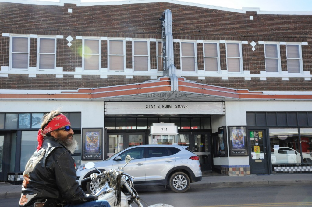 "(Press Staff Photo by Geoffrey Plant)  ""We might be stuck in place for a long time,"" Bobby Lucero predicted March 16, when he rode his motorcycle from Hanover to Silver City to pay a visit to the Pretty Sweet Emporium on Bullard Street, across from the Silco Theatre. The theater's message, ""Stay Strong Silver,"" has remained on its marquee since March. Movie theaters remain closed and events such as concerts and large gatherings are still not allowed under the latest revised public health order issued today by Gov. Michelle Lujan Grisham — although the Silco continues to sell concession items curbside Thursday through Saturday evenings."