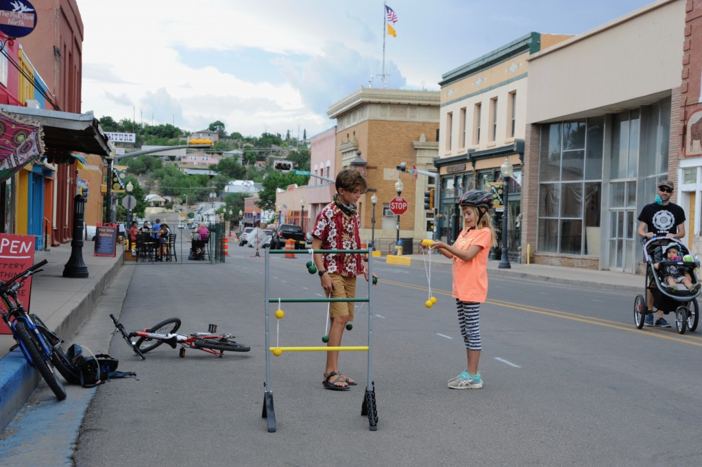 """(Press Staff Photo by Geoffrey Plant)  Eleven-year-old Jace Eagle and his 8-year-old sister, Astrid Eagle, took a break from the sling ball game set up outside one of downtown Silver City's many businesses Saturday and told the Daily Press that they support the temporary closure of Bullard Street to traffic. """"You don't have to look around everywhere for cars every time you go in the street,"""" Astrid said. """"It's more fun — we can do whatever we want."""" Silver City MainStreet and the town of Silver City are meeting today to determine whether the street closure should be a regular weekly event."""